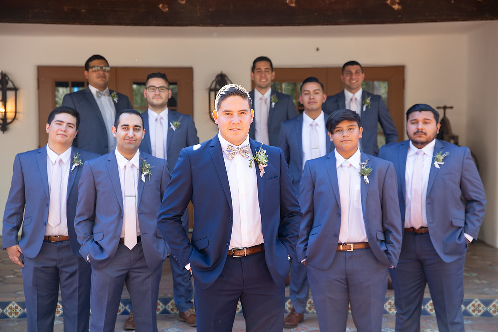 Groom and his groomsmen in cobalt blue tuxes rocking his succulent, rosemary and lavender filled boutonnière for a purple colored wedding at Rancho Las Lomas in Orange County, CA made by San Diego Wedding Florist Le Champange Projects