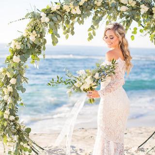 Round Floral Arch for wedding ceremony on Windansea Beach, in La Jolla, CA