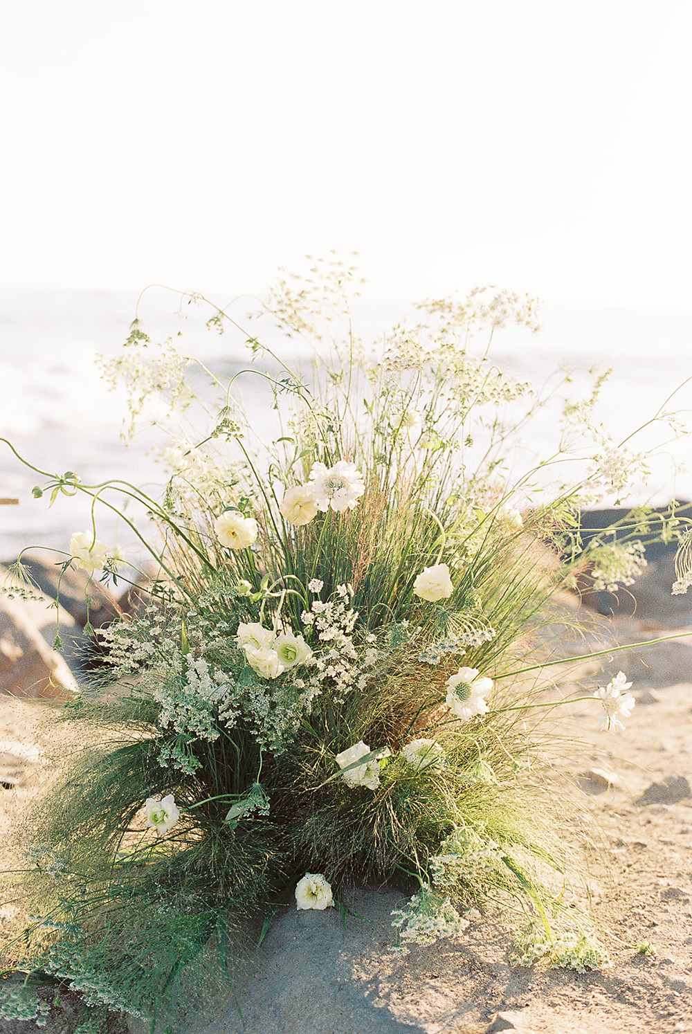 Foam Free growing romantic flower installation for beach elopement in Dana Point, California by Southern California Wedding florist Le Champagne Projects