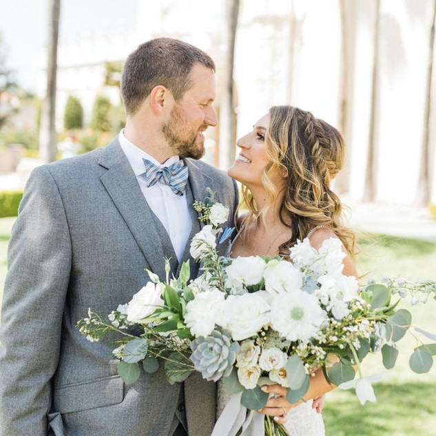 Lush garden style white and blue bridal bouquet with succulents for beach wedding in La Jolla San Diego