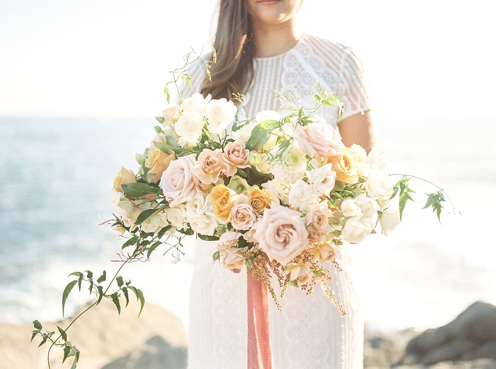 Beautiful late Summer Lush and Romantic Bridal Bouquet with blush and golden roses and flowing jasmine and pieris for this perfect Dana Point Seaside Elopement with flowers from San Diego Wedding Florist Le Champagne Projects