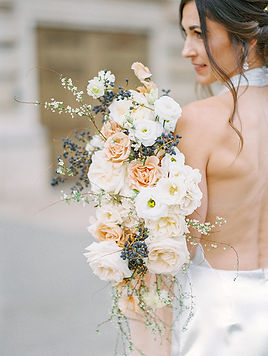 1920's inspired neutral and organic bridal bouquet made by San Diego Wedding Florist Le Champage Projects, held by chic bride at Balboa Park in San Diego, CA
