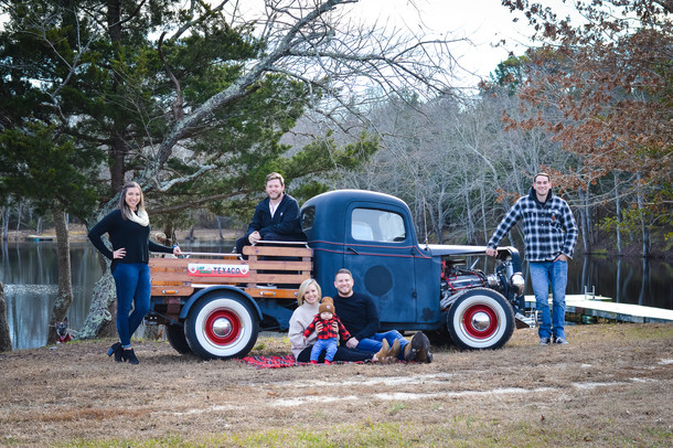 Family photo with vintage truck in December