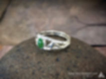 Silver Bamboo and Jade gemstone Ring  is the first ring offered by J. Sperry and another piece in the Bamboo & Jade Collection. The Bamboo collection features non symmetrical works of jewelry with organic flowing bamboo stalks and leaves highlighted with beautiful green Jade gemstones. The Bamboo and Jade Ring is composed of a sterling silver cast ring section depicting two parallel bamboo stalks with leaves spanning back and forth with a beautiful bezel set Jade gemstone in the middle.