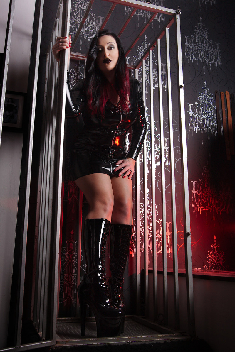 Domina in a cage