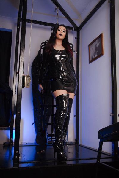 Mistress standing and bondage frame