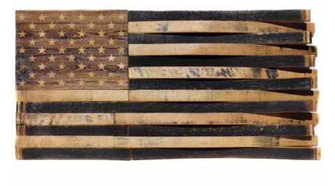 Flags made out of reclaimed bourbon barrels