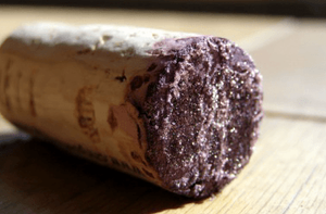 crystal deposits on the cork of an older wine