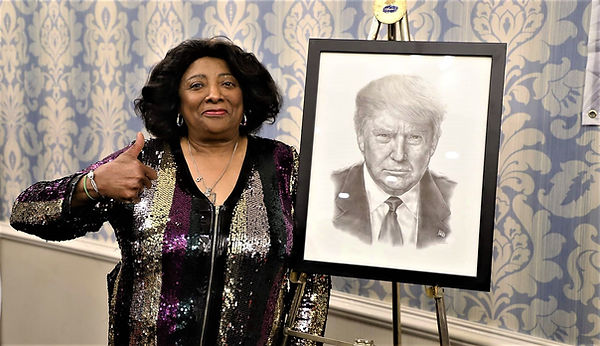 Barbara with a portrait of President Don