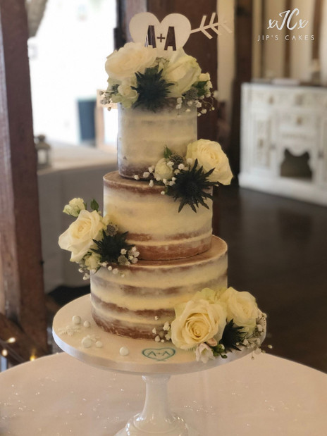 Semi-naked wedding cake with white Avalanche roses | Jip's Cakes | Wedding cakes Essex & Hertfordshire