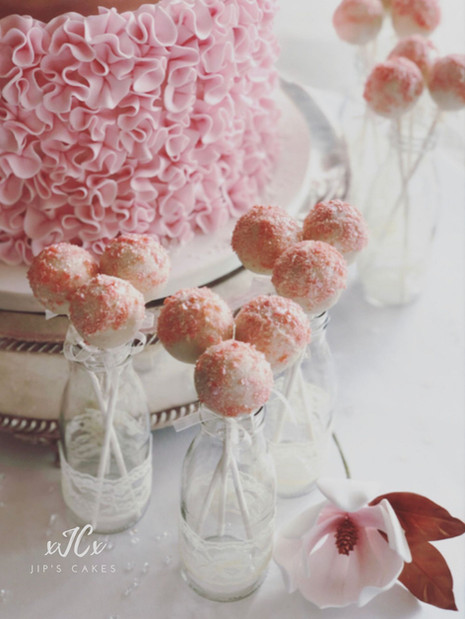 White cake pop with pink popping candy | Jip's Cakes | Wedding favours | Wedding cakes Essex | Wedding cakes Hertfordshire