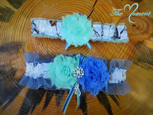 88f8bbc18 This adorable garter set is made of white True Timber Snowfall Satin Camo  print and aqua and blue organza. They are embellished with Aqua and Blue  shabby ...
