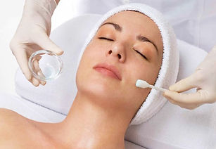 Woman receving a facial peel.