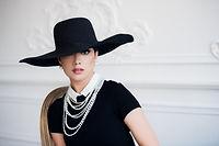 attractive-woman-wearing-black-dress-hat