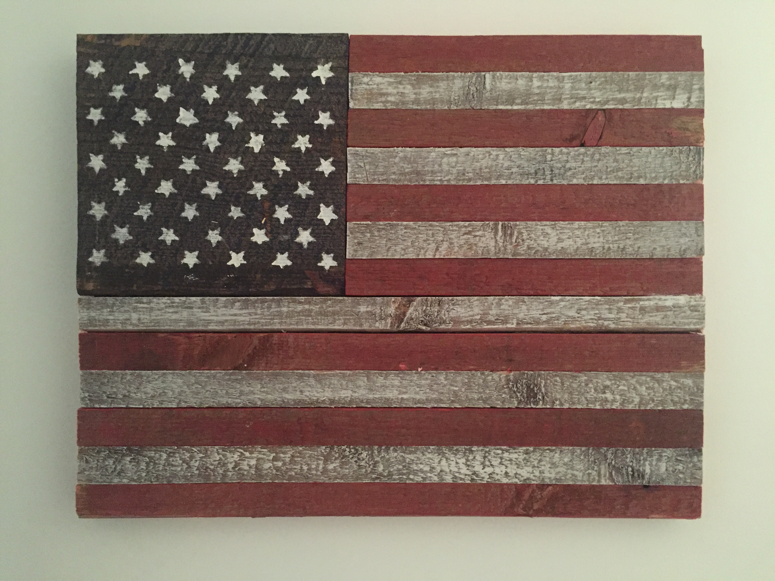 Rustic barn wood painted American flag can be made in any size. Shown here 13.5X17.5