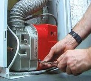 Boiler with hand G Johnston Services.jpg