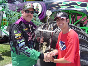 Gary Porter of Grave Digger receiving 2004 WMTRL Monster Truck Racing World Champion Trophy