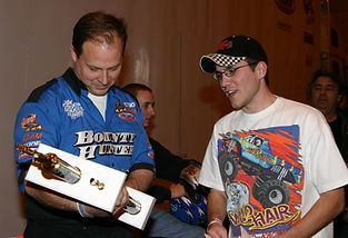 Jimmy Creten of Bounty Hunter receivin 2004 WMTRL Monster Truck Racing Trophy