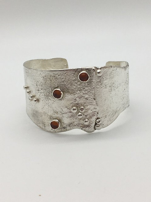 Reticulated sterling silver with amber