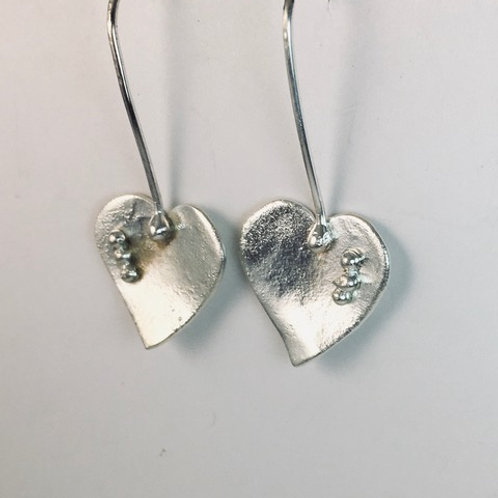 Reticulated silver hearts