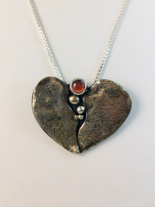 Oxidized sterling silver heart with garnet