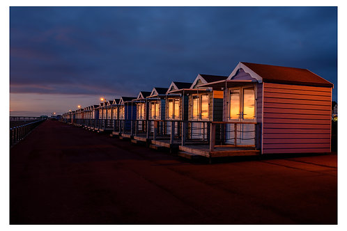 Beach huts sunset