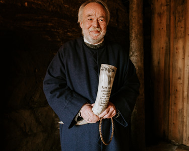 Priest in Iceland holding traditional horn