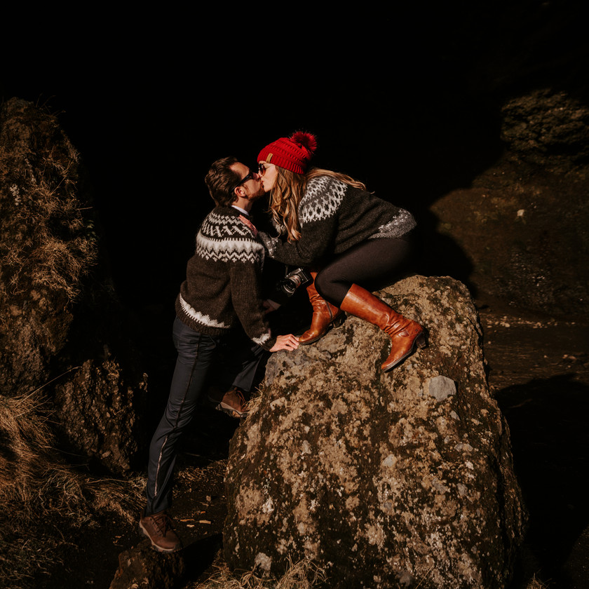Man and woman kissing wearing Icelandic wool sweaters at night