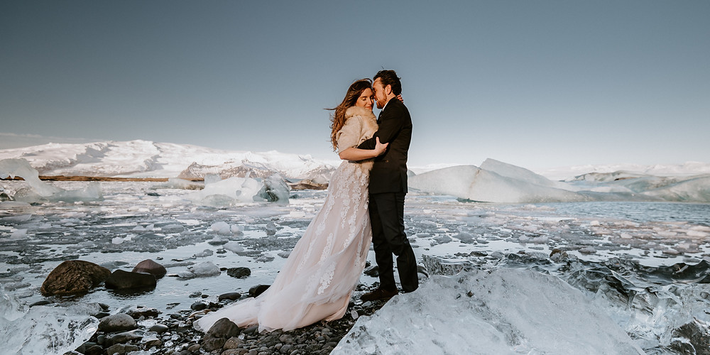 Man and Woman embracing in the snow in Iceland on wedding day