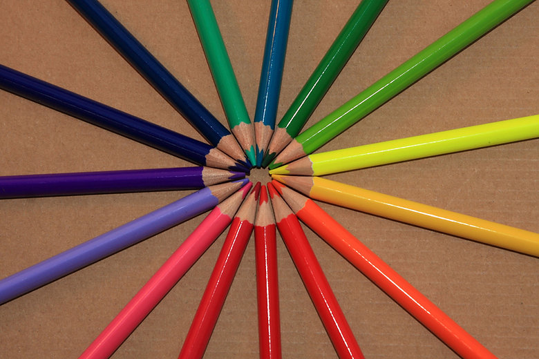 Circle of Colored Pencils Beige Background