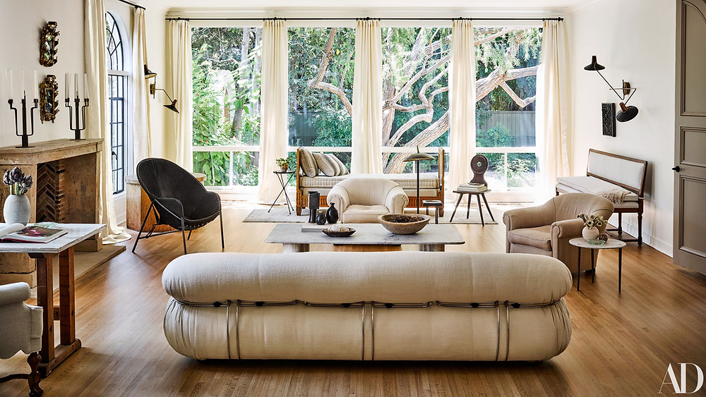 Arch digest Nate Berkus and Jeremiah Brent, studying great design with modern and traditional decor, asymmetrical design and wood floors.