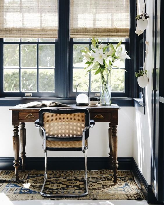 Small Office Desk next to windows with cane chair adorned with beautiful lillies, Small office inspiration from pinterest