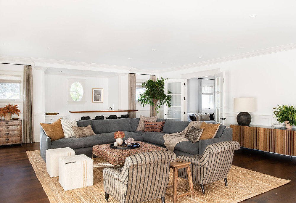 Living room design by Amber Interiors with linen sofa and upholstered chairs, inspiration photo for fabric for sofa or chair