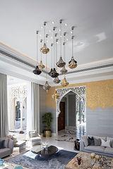 Moroccan living room showing hanging light fixtures