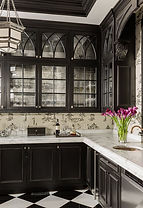 Gothic interior design kitchen with high arched see thru glass cabinets