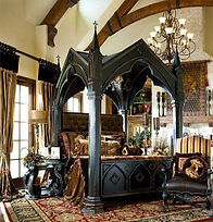 Gothic interior bedroom design with high arched bed and chandelier.
