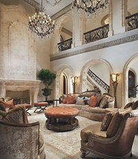 Interior decor  of a mediterranean room showing balcony with large chandeliers and oversized furnishings.