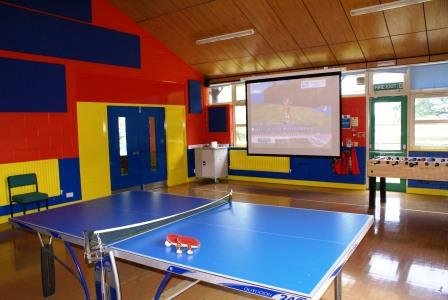 hall with toys out - showing big screen.JPG