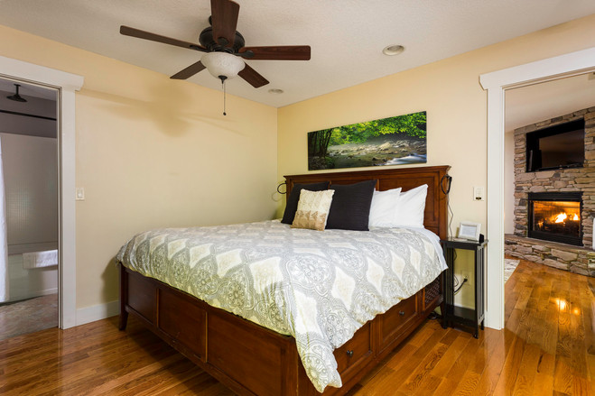King size bed and fireplace