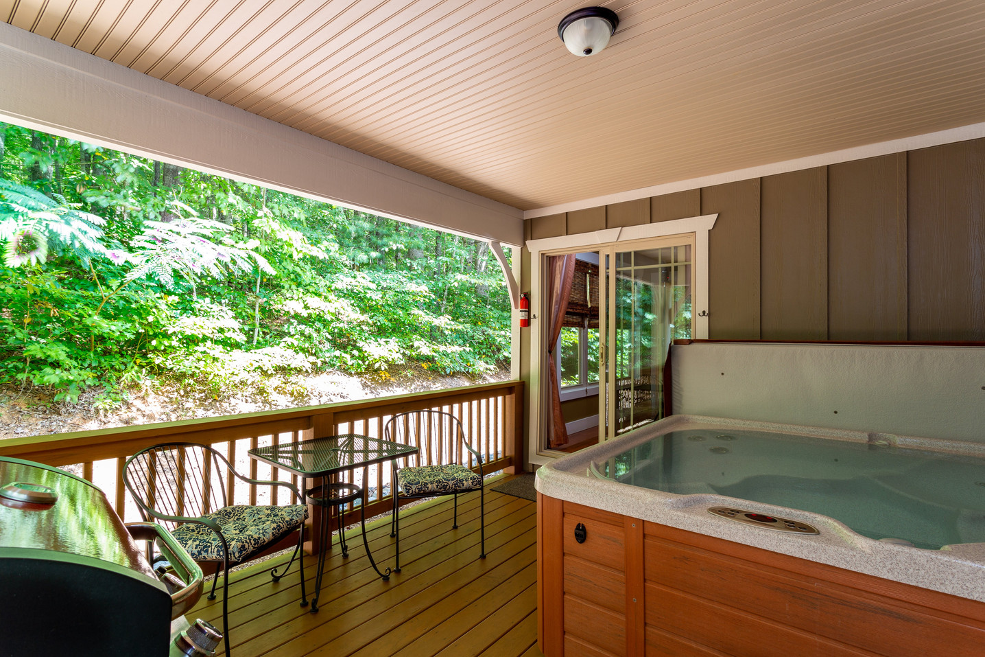 Large hot tub in each cabin in Asheville