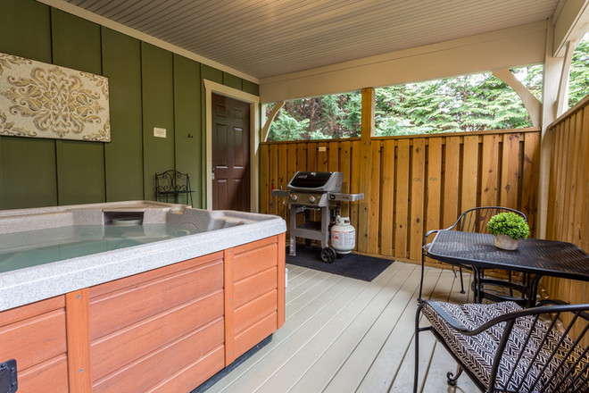 Gas grill and hot tub on the back deck