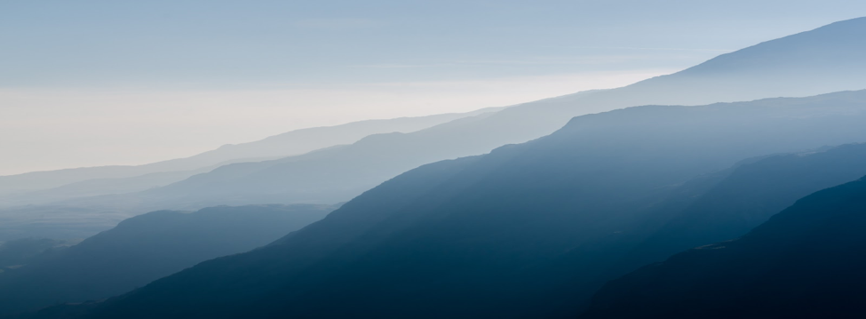 In the winter the Blue Ridge Mountains maintain their blueness from afar—but show more details up close, due to the bare trees.
