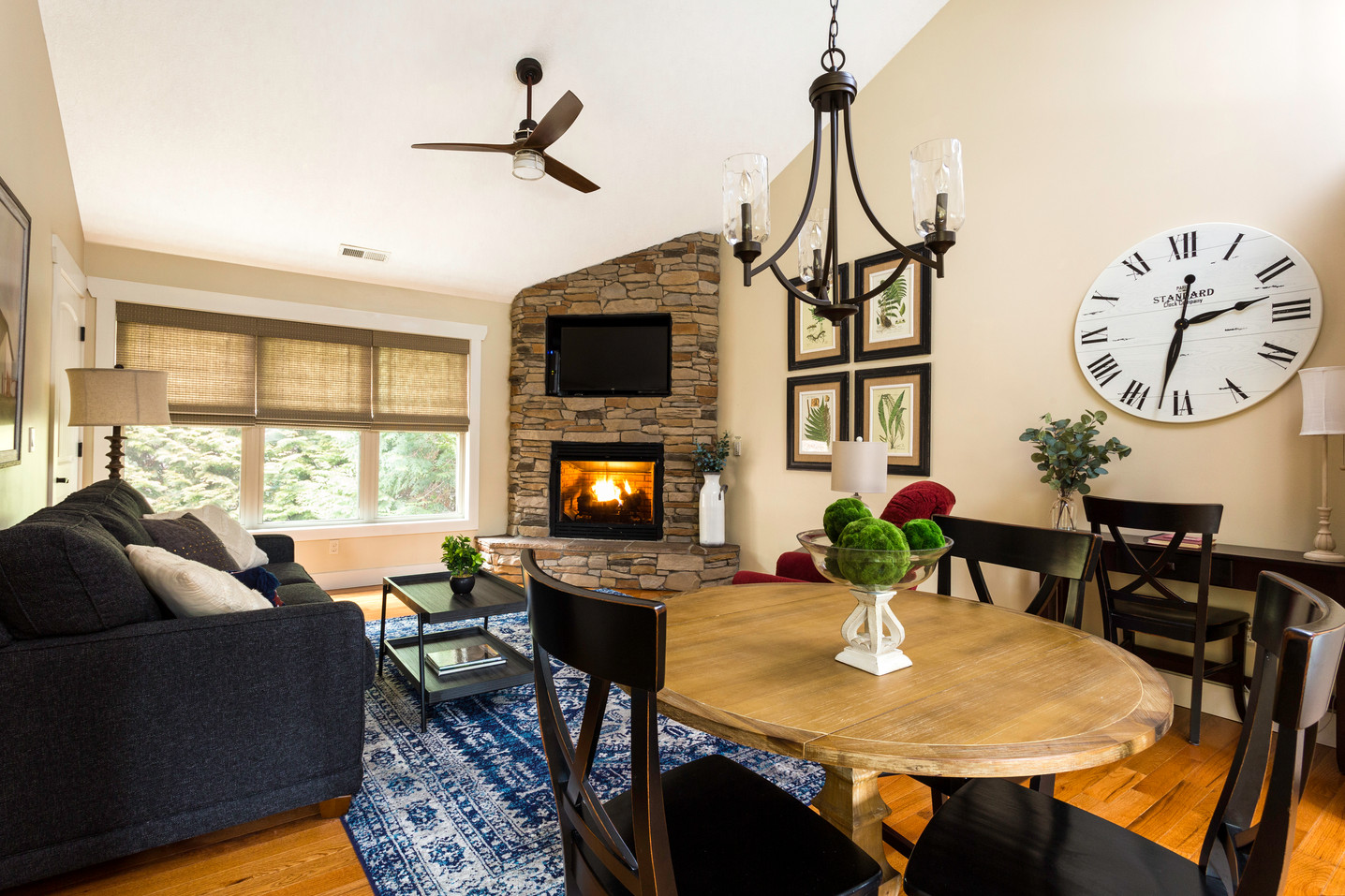 Large TV and fireplace in this cabin rental in Asheville