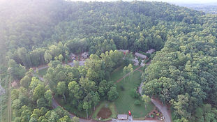 Aerial view of the cabins in the woods