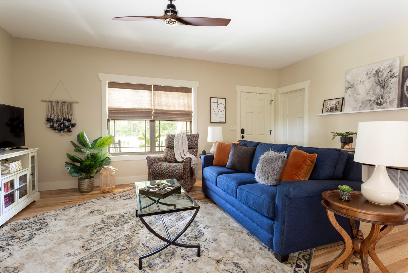A vacation rental in Asheville with a large TV and fireplace