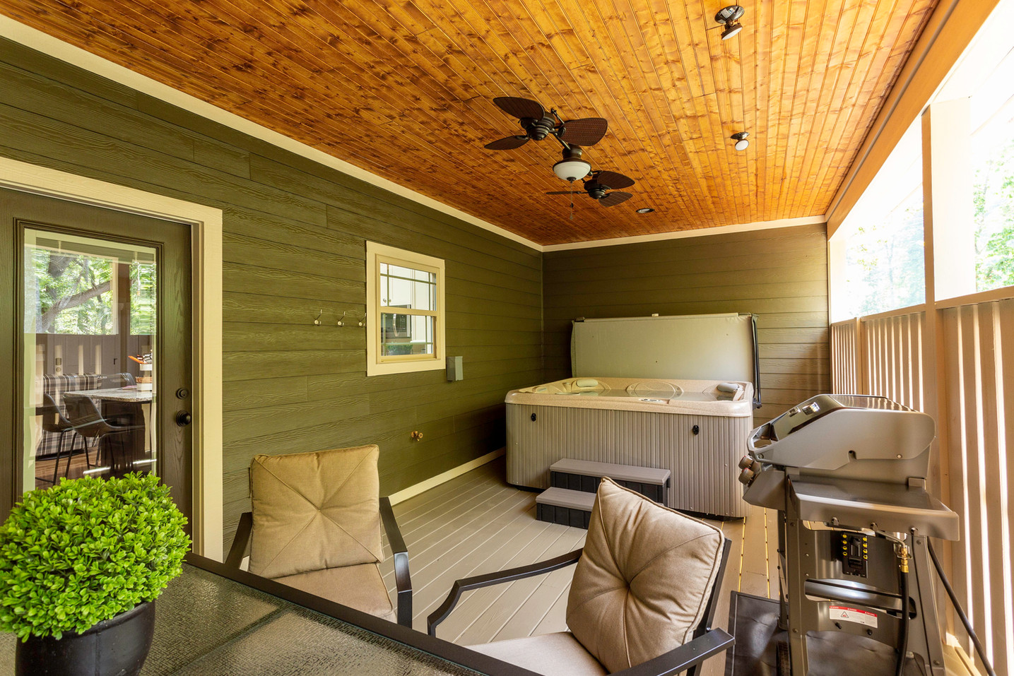 Large back deck with a hot tub