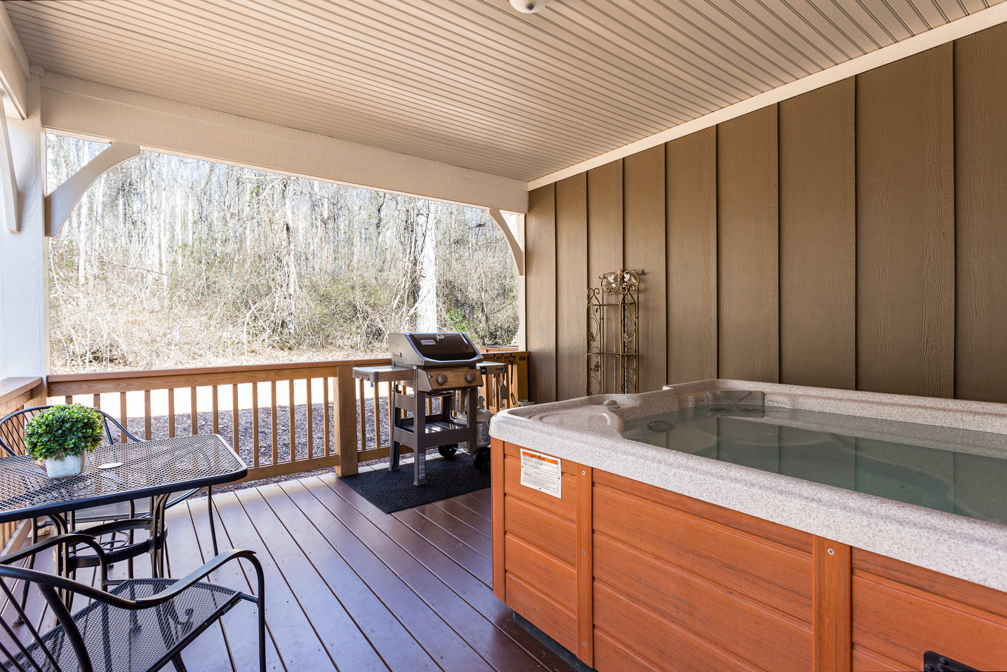 Hot tub and bistro table on the back deck