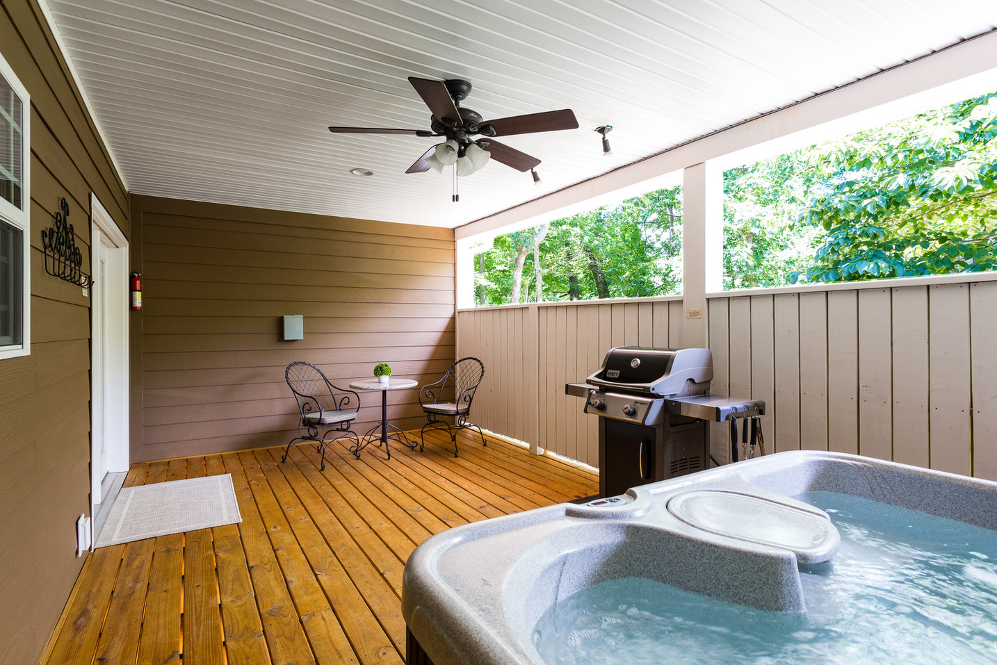 Romantic table and chairs, gas grill and crystal clear hot tub