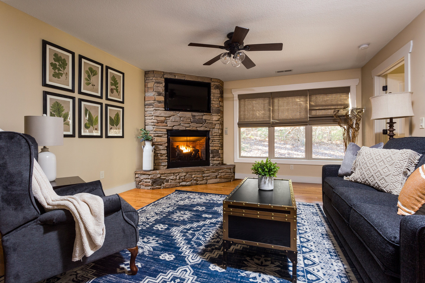 Fireplace, TV and a large recliner