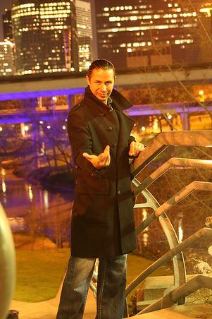 Eduardo standing hand out city.jpg
